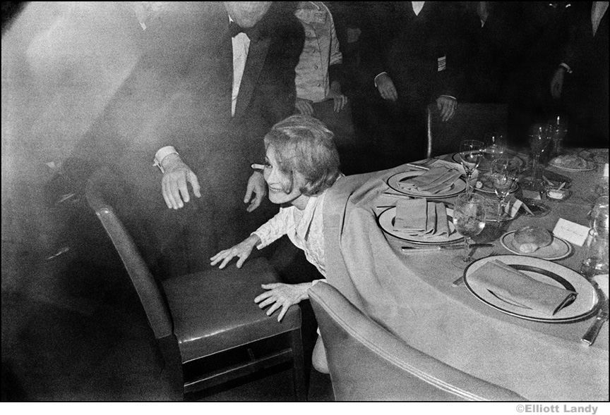 039 Marlene Dietrich, opening night party, hiding from photographers, NYC, 1968