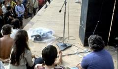 371 Joan Baez (back to camera) on stage, Woodstock Festival 1969, NY